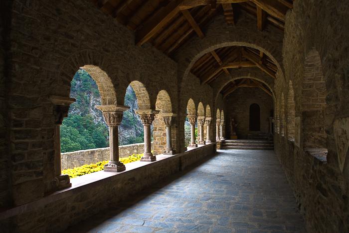 South wing of cloister, Abbaye Saint Martin-du-Canigou, Casteil (Pyrénées-Orientales)  Photo by Dennis Aubrey