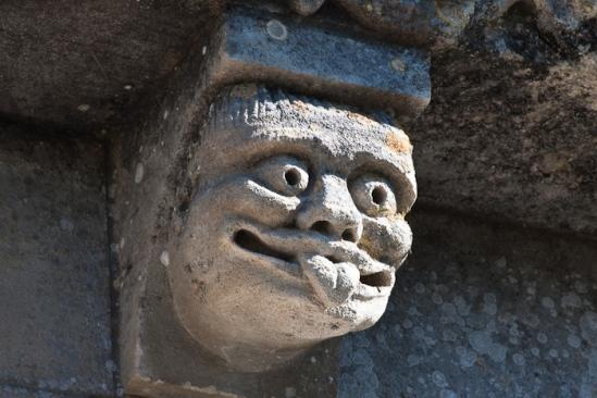 Man sticking out tongue, Prieuré Sainte Gemme, Sainte Gemme (Charente-Maritime) Photo by Dennis Aubrey