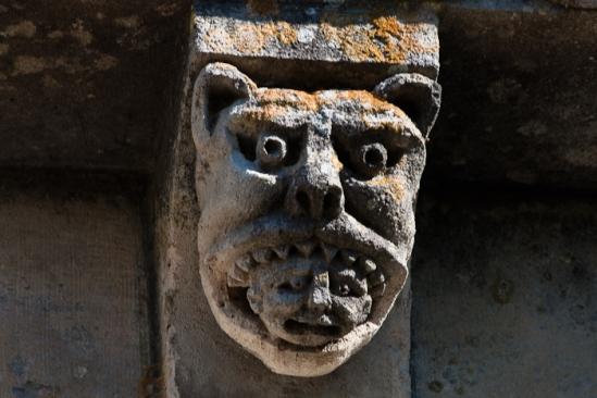 Lion with man in mouth, Prieuré Sainte Gemme, Sainte Gemme (Charente-Maritime) Photo by Dennis Aubrey