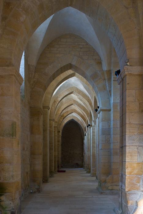 Side aisle, Église Abbatiale Notre Dame de Noirlac, Bruère-Allichamps (Cher) Photo by Dennis Aubrey