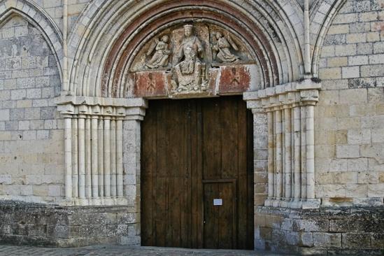 Portal and tympanum, Église Notre-Dame de Cunault, Cunault (Maine-et-Loire) Photo by PJ McKey