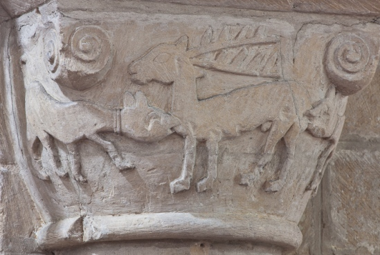 Romanesque dogs attacking deer, Église Notre-Dame-de-l'Assomption, Sainte Marie-du-Mont (Manche) Photo by Dennis Aubrey