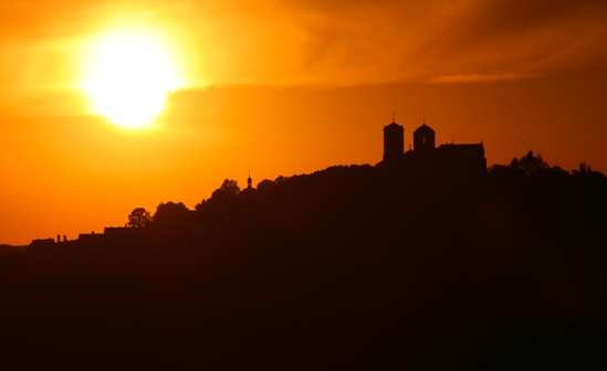 The sunset view across the valley to the Basilique Sainte Madeleine atop the hilltop village of Vézelay