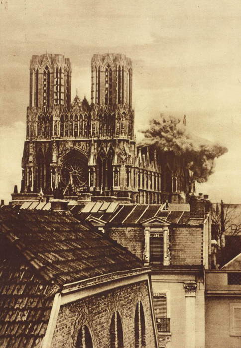 German shell bursting against Reims Cathedral on September 20, 1914