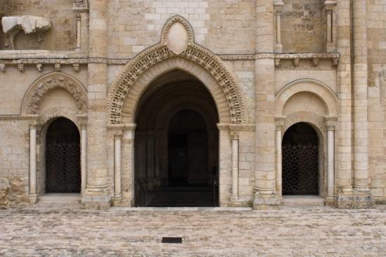 Western portals,  Église Saint-Pierre d'Airvault, Airvault (Deux-Sèvres) Photo by Dennis Aubrey