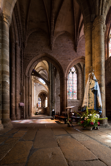 Side aisle with Madonna, Basilique Notre Dame-de-Bon-Secours. Guingamp (Côtes-d'Armor)  Photo by Dennis Aubrey